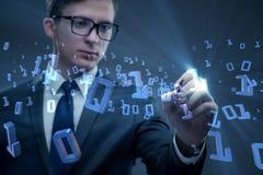 Бизнесмен отжимая бинарные кнопки в концепции техника Стоковое Изображение RF