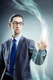 Бизнесмен отжимая виртуальные кнопки в футуристической концепции Стоковое фото RF