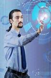 Бизнесмен отжимая виртуальные кнопки в футуристической концепции Стоковое Изображение