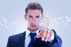 Бизнесмен отжимая ВКЛЮЧЕНО-ВЫКЛЮЧЕНО кнопку стоковое изображение