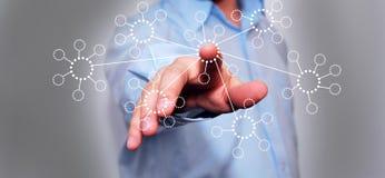Бизнесмен отжимая высокотехнологичную кнопку Стоковое Изображение RF