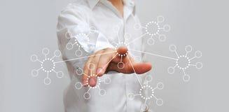 Бизнесмен отжимая высокотехнологичную кнопку Стоковое фото RF
