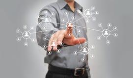 Бизнесмен отжимая высокотехнологичную кнопку Стоковая Фотография RF