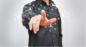 Бизнесмен отжимая высокотехнологичную кнопку Стоковая Фотография