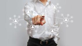 Бизнесмен отжимая высокотехнологичную кнопку Стоковые Фото