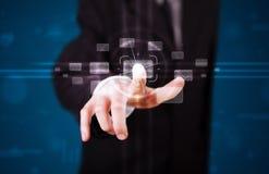 Бизнесмен отжимая высокотехнологичный тип современных кнопок Стоковое Фото