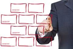 Бизнесмен отжимая конструированные кнопки Стоковое Изображение