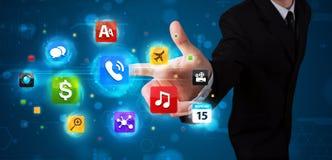Бизнесмен отжимая различное собрание кнопок Стоковые Изображения RF