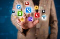 Бизнесмен отжимая различное собрание кнопок Стоковые Фотографии RF