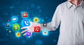 Бизнесмен отжимая различное собрание кнопок Стоковое Изображение RF