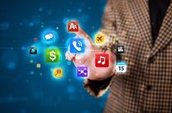 Бизнесмен отжимая различное собрание кнопок Стоковые Изображения