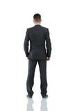 Бизнесмен от задней части - смотреть что-то над белым ба Стоковое Фото