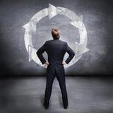 Бизнесмен перед рециркулирует символ Стоковые Фотографии RF