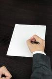 Бизнесмен пишет, выше стоковое фото
