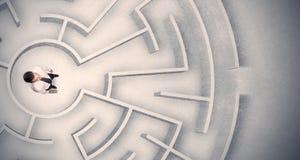 Бизнесмен поглощенный в круговом лабиринте Стоковые Изображения RF