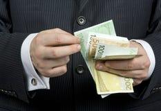 бизнесмен подсчитывая деньги Стоковое Фото