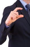 Бизнесмен показывать малый размер с перстами. стоковая фотография