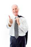 Бизнесмен показывая большие пальцы руки поднимает жест стоковые фотографии rf