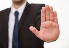 Бизнесмен показывая знак стопа Стоковая Фотография RF