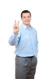 бизнесмен показывая победу знака стоковая фотография