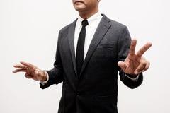 Бизнесмен показывая руку и палец стоковая фотография