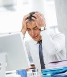 Бизнесмен под стрессом Стоковая Фотография