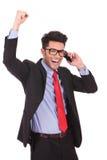 Бизнесмен празднует на телефоне Стоковое фото RF