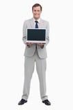 Бизнесмен представляя экран его компьтер-книжки Стоковая Фотография