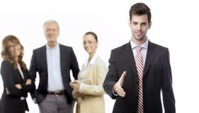 Бизнесмен предлагая для рукопожатия Стоковая Фотография