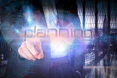 Бизнесмен представляя планирование слова стоковые фото