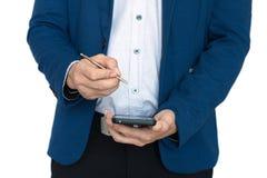 Бизнесмен принимает примечания с smartphone Стоковые Фото