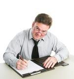 Бизнесмен принимая примечания стоковое фото