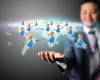 Бизнесмен принимая социальную сеть Стоковая Фотография RF