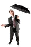 бизнесмен проверяя если идущ дождь Стоковое Изображение