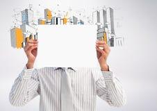 Бизнесмен проводя пустой плакат перед его стороной против офисных зданий нарисованных рукой в backgr Стоковые Фотографии RF