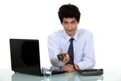 Бизнесмен работая на компьтер-книжке Стоковая Фотография RF
