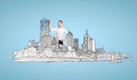 Бизнесмен рисуя абстрактный город Стоковое фото RF