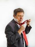 Бизнесмен связывая его связь Стоковая Фотография RF
