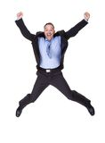 Бизнесмен скача в утеху Стоковая Фотография RF