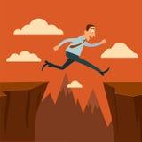 Бизнесмен скача над бездны Стоковое фото RF