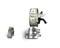 Бизнесмен скача через круг на стоге символов денег Стоковая Фотография RF