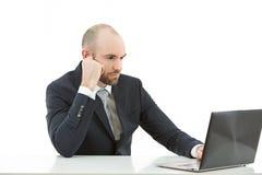 Бизнесмен сконцентрированный на его работе Стоковая Фотография RF