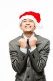 Бизнесмен смешанной гонки празднуя рождество изолированное на белом b Стоковые Фотографии RF