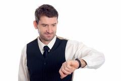 Бизнесмен смотрит на его вахте стоковые изображения rf