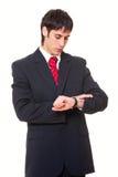 бизнесмен смотря вахту Стоковые Изображения