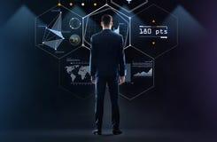 Бизнесмен смотря виртуальный экран от задней части Стоковая Фотография RF
