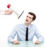 Бизнесмен смотря мегафон Стоковая Фотография RF