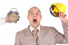 Бизнесмен смотря сигнал тревоги часов стоковое фото