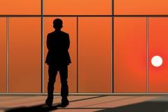 Бизнесмен смотря через окно Стоковые Изображения RF