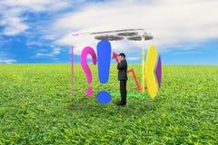 Бизнесмен стоя в стеклянном кубе Стоковые Изображения RF